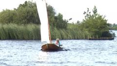 Classic flatboat yacht in Friesland (Holland) Stock Footage