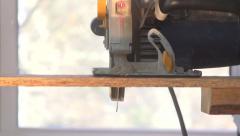 Circular Saw cutting wood towards camera slomo - stock footage