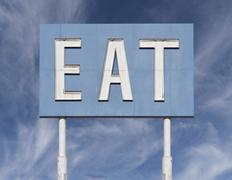 Vintage Blue Eat Sign with Cirrus Clouds Stock Photos