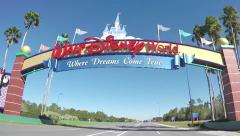 Slow motion drive under Disneyworld welcome sign Stock Footage