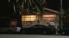 A quaint wooden house in Florida or California at night. Arkistovideo