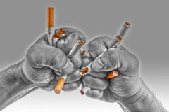 Human hands heatedly breaking cigarettes Stock Photos