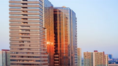 4k timelapse, the sunset light reflect on business building Stock Footage