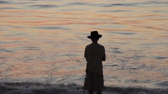 Silhouette of man with a hat walking at the beach, Mazatlan, Mexico  Stock Footage