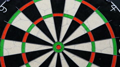 The camera goes to the bull's eye of the dart board pretending to be a dart - stock footage