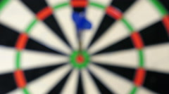 The camera goes to the bull's eye of the dart board pretending to be a dart Stock Footage