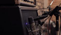Recording guitar amp in studio Stock Footage