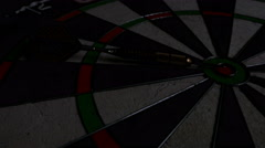 Light sweep effect on a dart board, a dart laying and pointing the bull's eye - stock footage