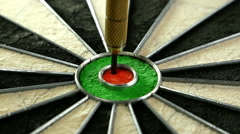 3 darts hitting the bull's eye on a dart board and player's hand picking them up - stock footage