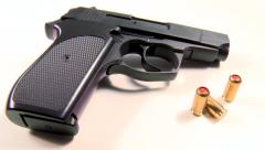 Pepper gas-cartridges and semi-automatic handgun, beauty-shot close-up Stock Footage
