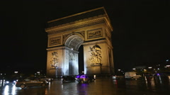 PARIS, FRANCE - NOVEMBER 2010: Paris Arc de Triumph night traffic Stock Footage