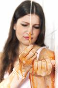 Unhappy lady dipped in slime - stock photo