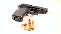Semi-automatic handgun with golden teargas cartridges Stock Footage