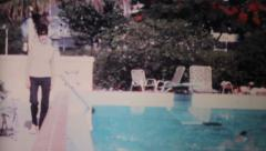 Classy Lady Walking Beside Pool-1969 Vintage 8mm film - stock footage