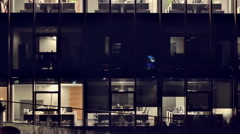 Night Vilnius. The end of the working day. Offices in the Skyscraper 2 Pan Stock Footage