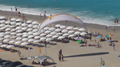 Paraglide after a spectacular landing on  beach. Ionian island. Stock Footage