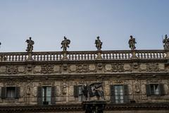 Human Statue on Top of Architectural Old Building Stock Photos