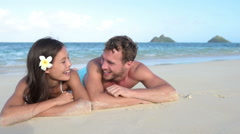Couple in love relaxing on beach - vacation travel summer holidays Stock Footage
