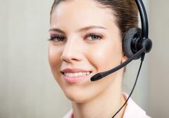 Closeup Of Customer Service Agent Wearing Headset Kuvituskuvat