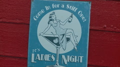 A sign announces ladies night at a bar. Stock Footage