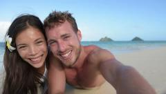 Couple relaxing on beach taking selfie picture -  Candid real close up - stock footage