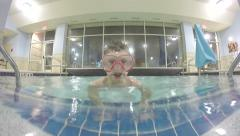 Boy swimming up super close to camera wearing a mask Stock Footage