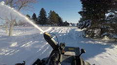 4k first person view of snowblowing snow Stock Footage