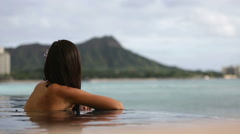 Stock Video Footage of Holidays vacation wellness pool spa woman relaxing by beach
