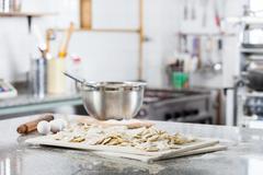 Unprepared Ravioli Pasta At Countertop In Commercial Kitchen - stock photo