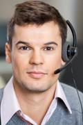 Confident Customer Service Representative Wearing Headset Kuvituskuvat