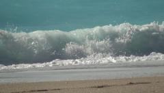 Big, white and foaming waves in a beautiful blue sea. Summer holiday season. Stock Footage