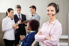 Confident Customer Service Representative Standing Arms Crossed Kuvituskuvat