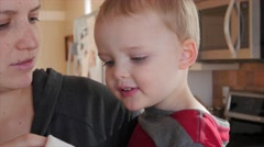 Little toddler blows nose into kleenex Stock Footage