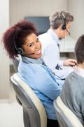 Smiling Female Customer Service Representative In Office Kuvituskuvat