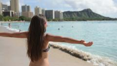 Beach woman in bikini i happy and free on Waikiki, Oahu, Hawaii Stock Footage