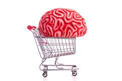 Brain and shopping cart - stock photo