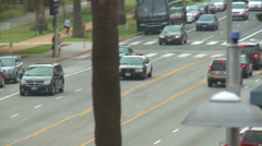 A police car drives on a downtown Los Angeles street by day. Stock Footage