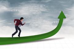Businessman achieve profit - stock photo