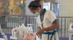 Cosmetician Providing Facial Spa Treatment with the Aid of Special Equipment Stock Footage