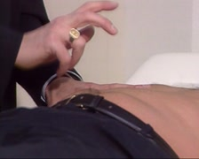 Stock Video Footage of Health checkup: Percussion of the patients abdomen