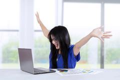 Cheerful businesswoman celebrate her achievement Stock Photos