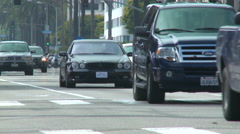 A black Mercedes drives down a Los Angeles street. Stock Footage