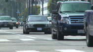 Stock Video Footage of A black Mercedes drives down a Los Angeles street.