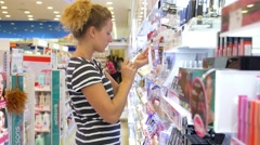 Girl Testing Cosmetics in a Beauty Store - stock footage