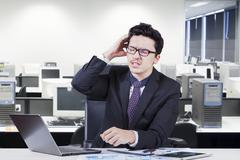 Confused male accountant with paperwork Stock Photos