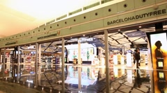 Stock Video Footage of Duty Free Shop at Barcelona International Airport, Spain.