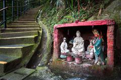 Outdoor shrine containing statues of the Goddess of Mercy and Guan Yu, Hong K Stock Photos
