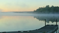 Early morning video of mist over Toddy Pond, Maine Stock Footage