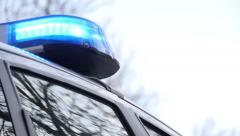 Police car leaves with blue light signal. Stock Footage