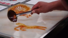 China traditional folk arts and crafts, painting with syrup Stock Footage